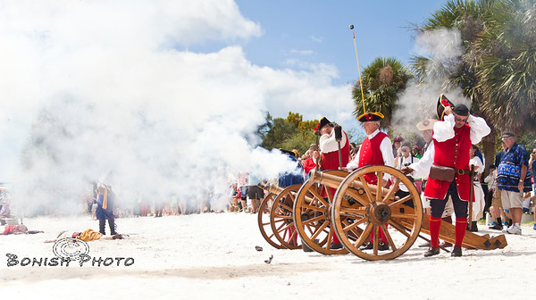 Red Coats Firing their Cannons on the Pirates off of Cedar Key Beach - Cedar Key Pirate Fest - Photo by Pat Bonish