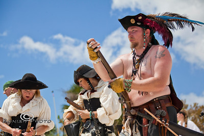 Pirates Loading their Weapons getting ready for battle - Cedar Key Pirate Fest - Photo by Pat Bonish