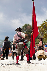 Planting their Flag and claiming their turf - Cedar Key Pirate Fest - Photo by Pat Bonish