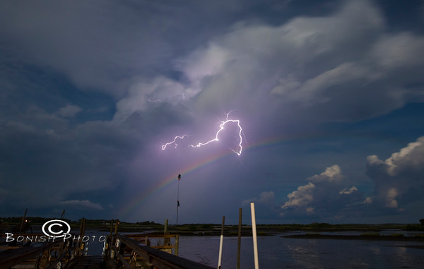 Moon Bow along with a Lightning Strike behind the Low-Key Hideaway, Cedar Key Florida - Photo by Pat Bonish